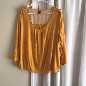 Yellow blouse with white details